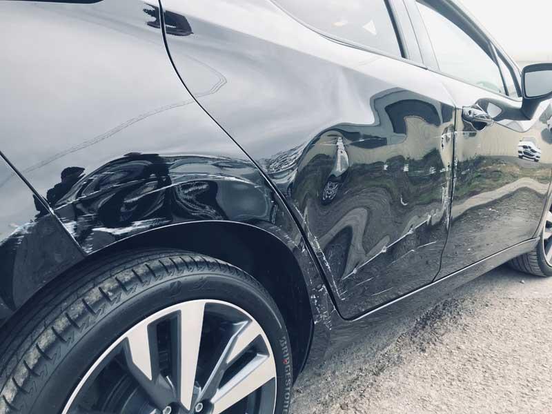 side of scratched black car