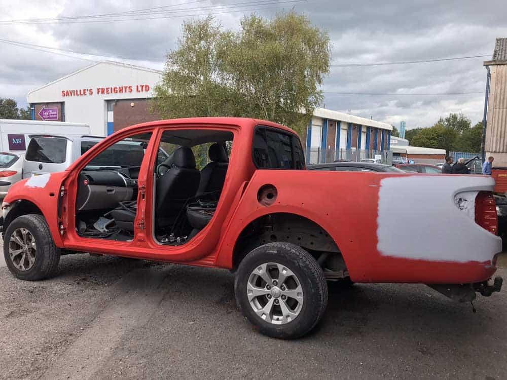red Mitsubishi without doors